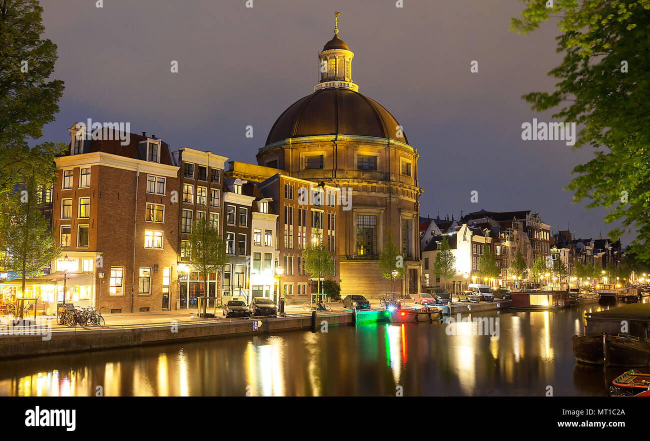 Round Koepelkerk with copper dome next to Singel canal in Amsterdam, the Netherlands. - Stock Image