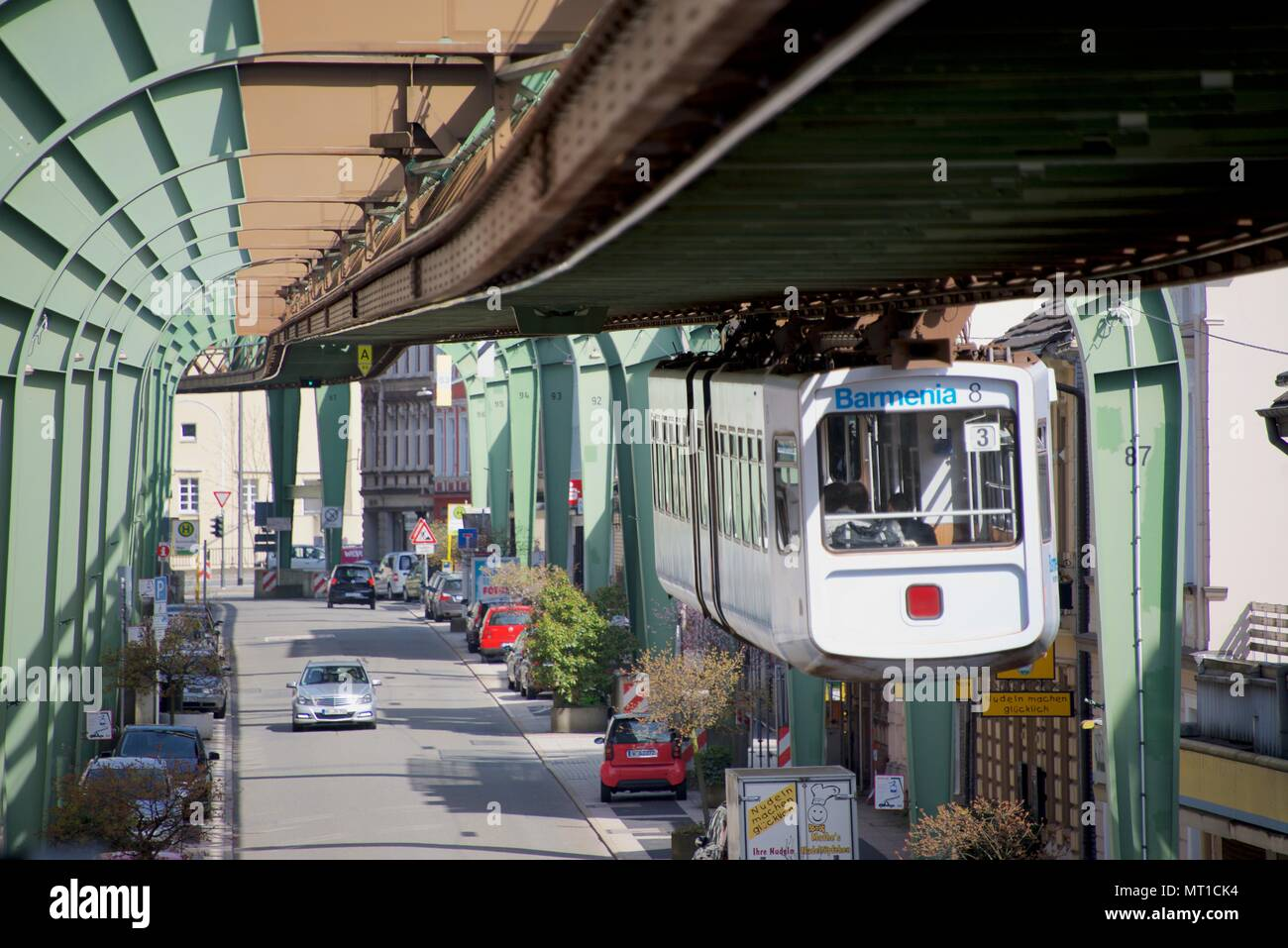Schwebebahn car arrives at the station in Wuppertal, Germany Stock Photo