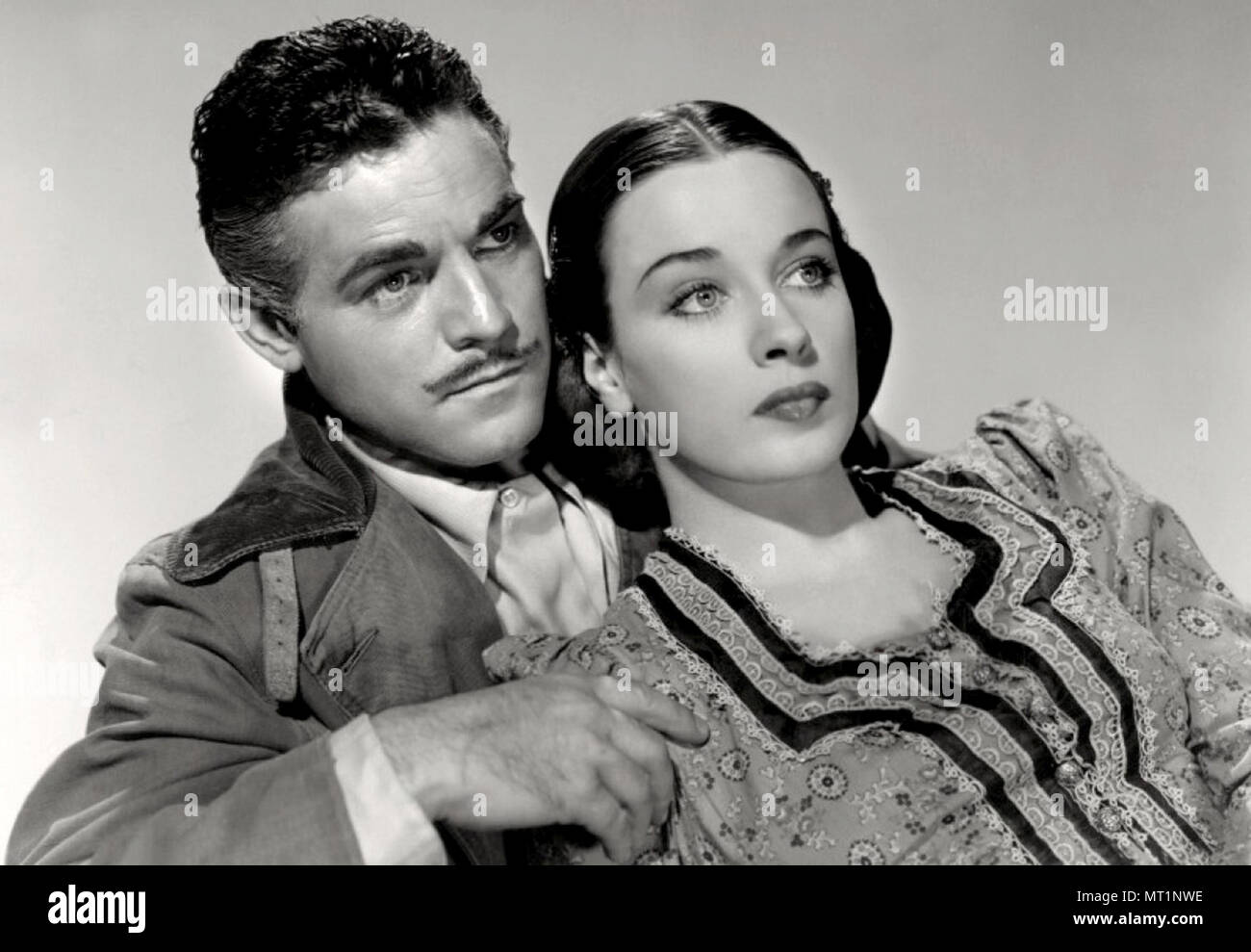 Alan Curtis and Patricia Morison in Hitler's Madman (1943) - Stock Image