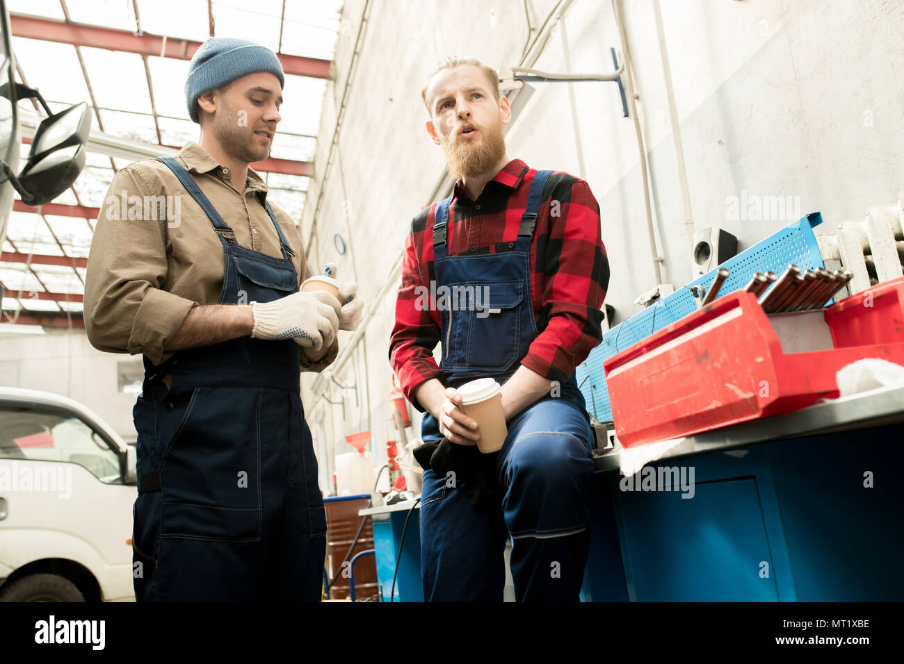 Auto Mechanics Chatting On Break - Stock Image
