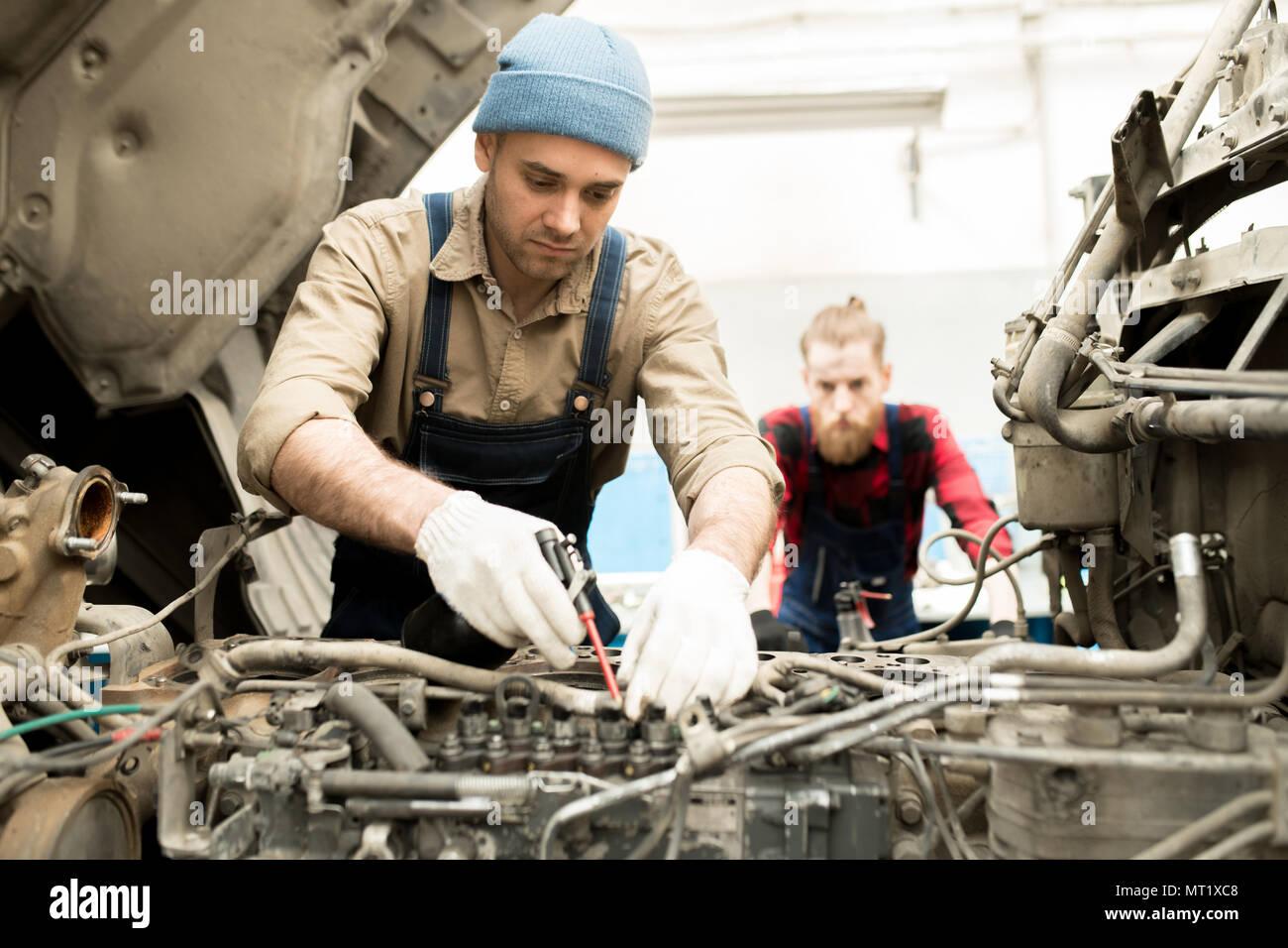 Auto Mechanic Repairing Truck - Stock Image