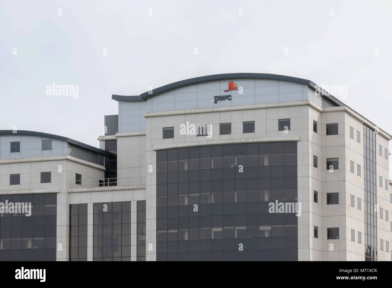 The PriceWaterhouseCooper offices at the Waterfront Plaza on the banks of the River Lagan in Belfast, Northern Ireland. - Stock Image