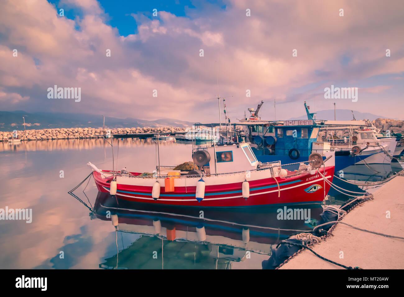 Small Fishing Boat / Vessel in Alykanas Boatyard at Sunrise, Dramatic colouring applied. Zante (Zakynthos) Greek Ionian Islands - Stock Image