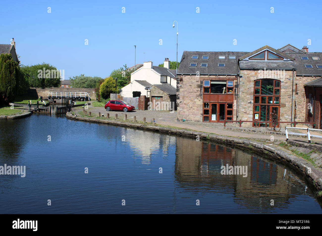 Nova Scotia Wharf in Blackburn, Lancashire on the Leeds and Liverpool canal with the Bob Watts building to the right of the canal towpath. - Stock Image