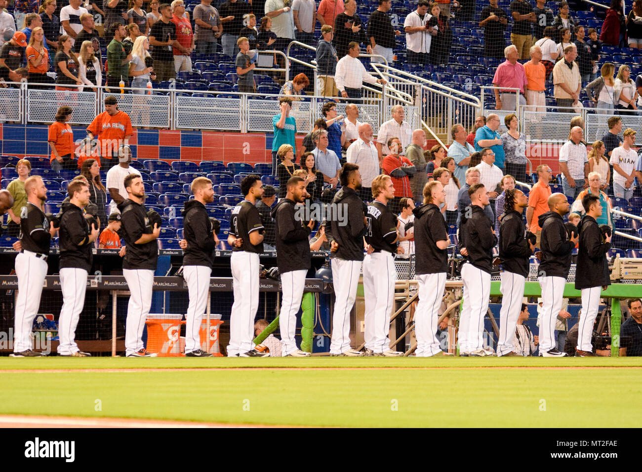 Miami, Florida, USA. 27th May, 2018. Miami Marlins team stand up during the national anthem during the baseball match between Nationals Washington and Miami Marlin at Marlins Park. Credit: Fernando Oduber/SOPA Images/ZUMA Wire/Alamy Live News - Stock Image