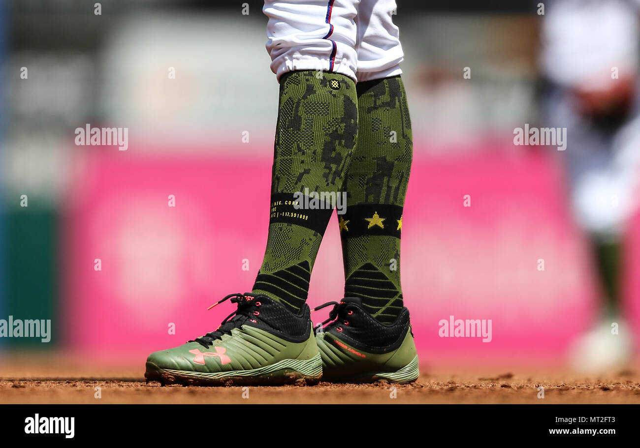 Arlington, Texas, USA. 27th May, 2018. Texas Rangers first baseman Ronald Guzman (67) wears special socks for the Memorial Day weekend game between the Kansas City Royals and the Texas Rangers at Globe Life Park in Arlington, Texas. Kansas City won the game 5-3. Tom Sooter/CSM/Alamy Live News - Stock Image