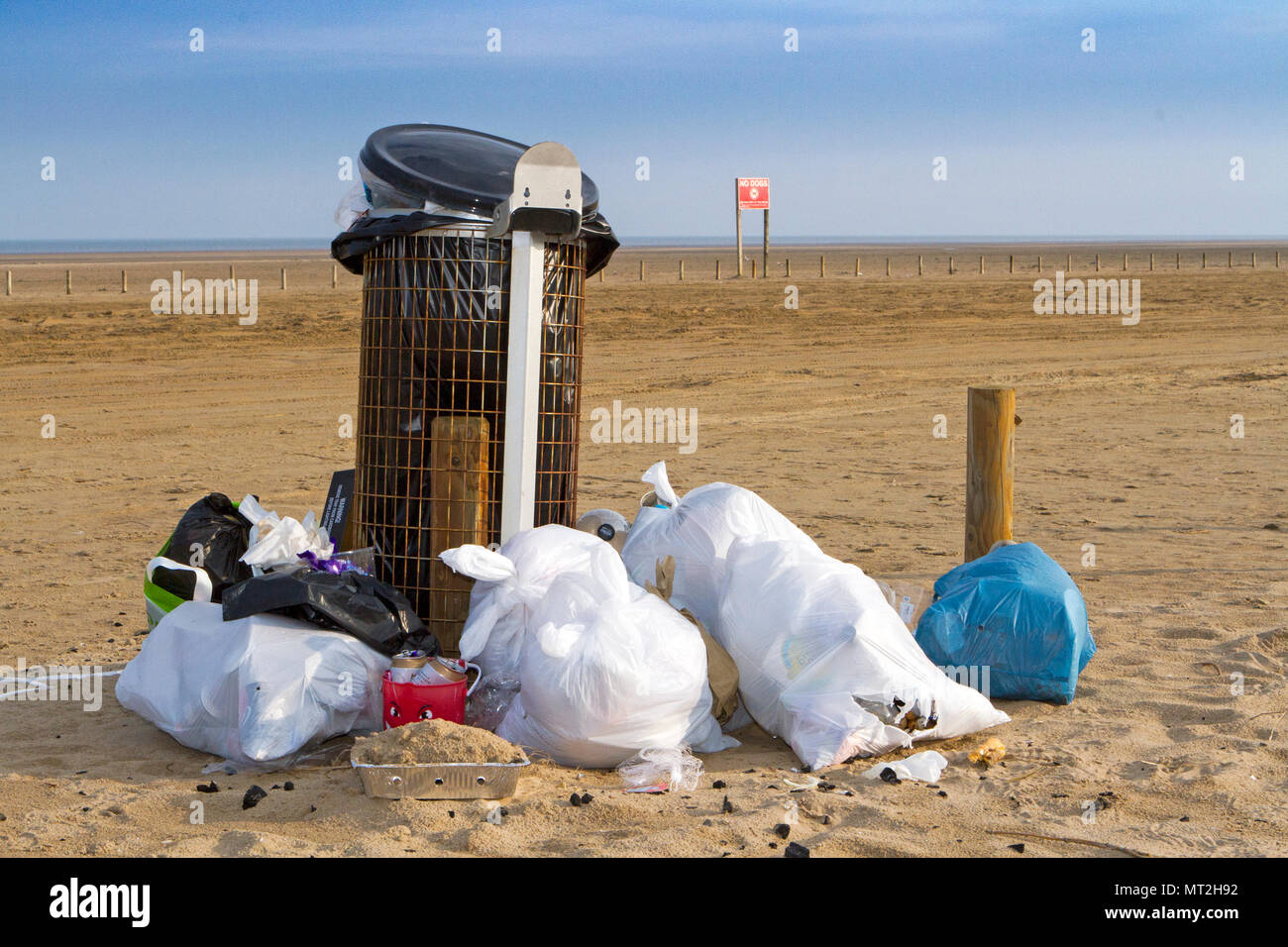 Filthy Beach, Southport, Merseyside. 28th May 2018. Bank Holiday revellers leave Southport's beaches strewn with rubbish, discarded barbecues and empty beer cans.  Beauty spots were covered in litter and bags of rubbish were piled-up next to overflowing bins.  Many simply left their rubbish behind after having barbecues and drinks in the great outdoors - forcing local clean up squads to leap into action today. While some attempted to clear up by placing their litter near a bin, the nature spots were still blighted by mountains of festering rubbish.  Credit: Cernan Elias/Alamy Live News Stock Photo