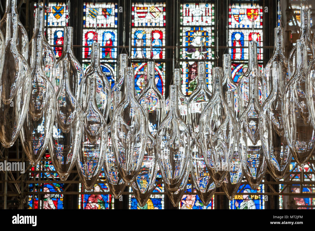 Canterbury, UK. 27th May, 2018. 'Under An Equal Sky', a major art installation is opened in Canterbury Cathedral. It marks the centenary of the end of the First World War. The work is by the artists Monica Guggisberg and Philip Baldwin, who work mostly in glass. This piece, hanging in the nave of the cathedral, is called 'Boat of Remembrance' and refers to, among other things, the refugee crisis in the Mediterranean. - Stock Image