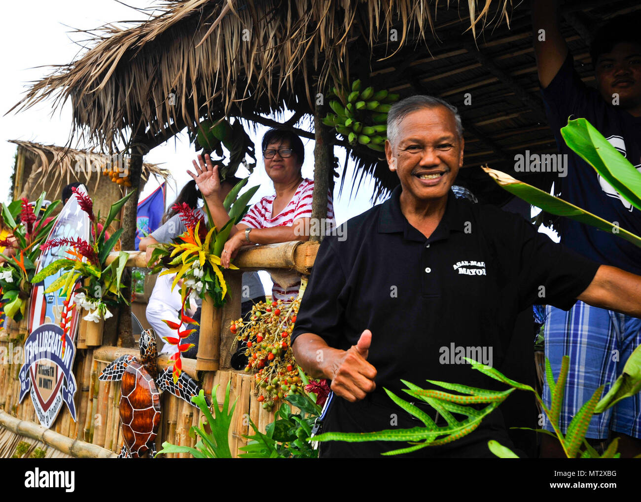 170721-N-YJ133-268  HAGATNA, Guam (July 21, 2017) Frankie Salas, mayor of Asan-Maina, Guam, gives a thumbs-up from his village's parade float during Guam's annual Liberation Day Parade in Hagatna, Guam, July 21. The 2017 Guam Liberation Parade celebrates the 73rd anniversary of the liberation of Guam from Japanese occupation by U.S. forces during World War II. (U.S. Navy photo by Mass Communication Specialist 2nd Class Richard Miller/Released) - Stock Image