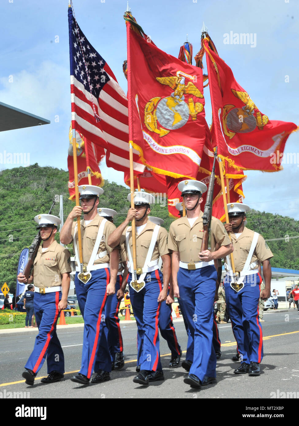 170721-N-ZD021-194  HAGATNA, Guam (July 21, 2017) A color guard from the Third Marine Division, based in Okinawa, Japan, marches during Guam's annual Liberation Day Parade in Hagatna, Guam, July 21. The 2017 Guam Liberation Parade celebrates the 73rd anniversary of the liberation of Guam from Japanese occupation by U.S. forces during World War II. (U.S. Navy photo by Mass Communication Specialist 3rd Class Daniel Willoughby/Released) - Stock Image