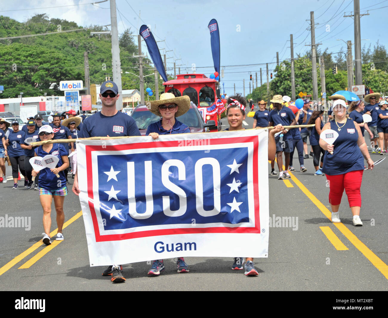 170721-N-ZD021-450  HAGATNA, Guam (July 21, 2017) Volunteers from the United Services Organization (USO) Guam carry a banner during Guam's annual Liberation Day Parade in Hagatna, Guam, July 21. The 2017 Guam Liberation Parade celebrates the 73rd anniversary of the liberation of Guam from Japanese occupation by U.S. forces during World War II. (U.S. Navy photo by Mass Communication Specialist 3rd Class Daniel Willoughby/Released) - Stock Image