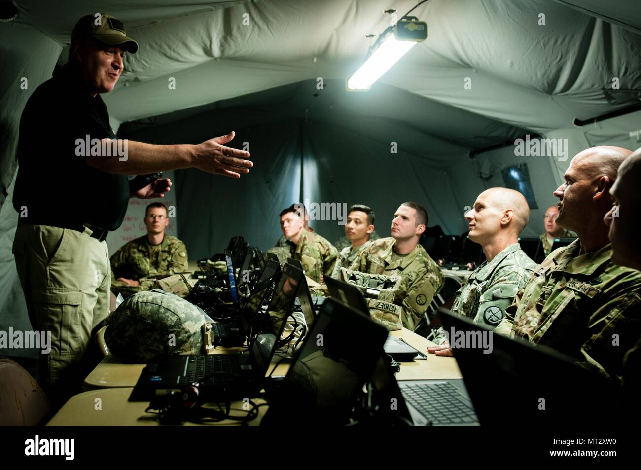 On July 16, 2017, Soldiers with the West Virginia Army National Guard's 863rd and 154th Military Police Companies listen to a briefing from Patrick Poirier, a business development manager for L3 Technologies, about the thermal night vision equipment the Soldiers will test during the 2017 National Jamboree on Summit Bechtel Reserve near Glen Jean, W.Va. The 2017 National Jamboree is being attended by 30,000 scouts, troop leaders, volunteers and professional staff members, as well as more than 15,000 visitors. Approximately 1,200 military members from the Department of Defense and the U.S. Coast - Stock Image