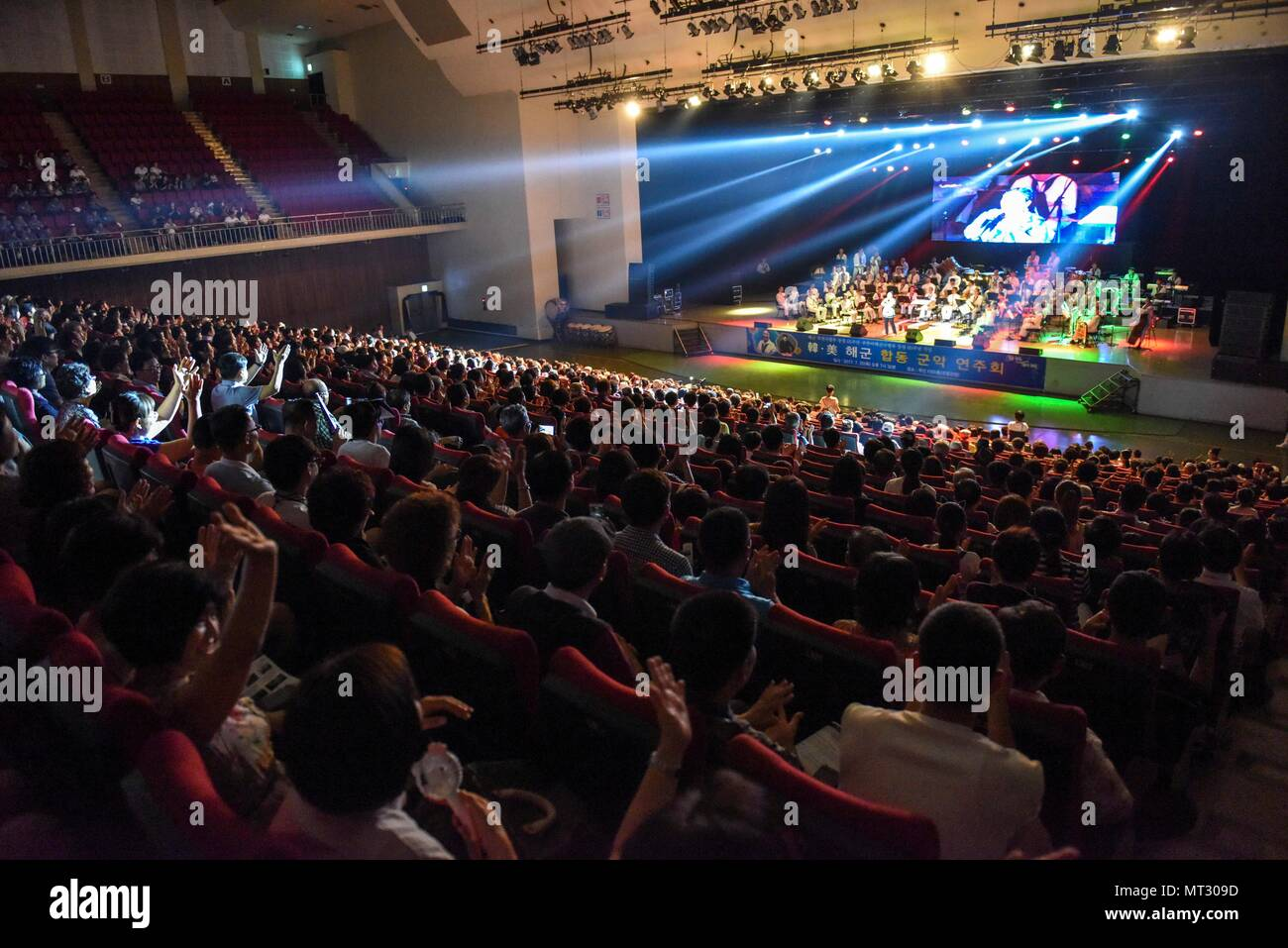 170720-N-WT427-583 BUSAN, Republic of Korea (July 20, 2017) Sailors from Combined Republic of Korea (ROK)-U.S. Navy Band performs during a combined anniversary celebration. The performance was held to celebrate both Commander, Naval Forces Korea's (CNFK) 60th anniversary and Republic of Korea (ROK) Fleet's 65th anniversary. CNFK is the U.S. Navy's representative in the ROK, providing leadership and expertise in naval matters to improve institutional and operational effectiveness between the two navies and to strengthen collective security efforts in Korea and the region. (U.S. Navy photo by Ma Stock Photo