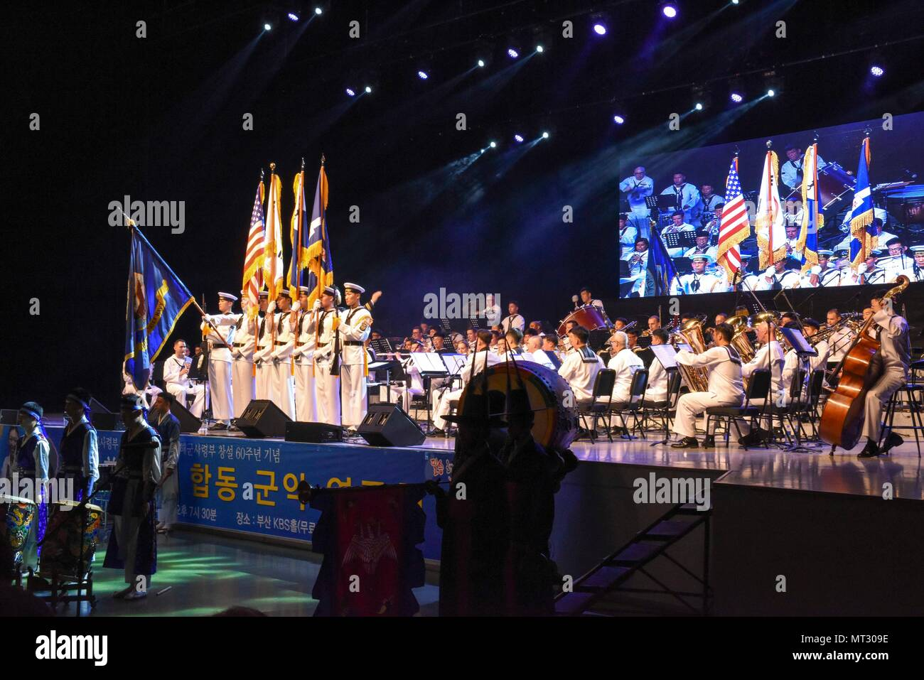 170720-N-WT427-166 BUSAN, Republic of Korea (July 20, 2017) Sailors from Combined Republic of Korea (ROK)-U.S. Navy Band performs the national anthem during a combined anniversary celebration. The performance was held to celebrate Commander, Naval Forces Korea's (CNFK) 60th anniversary and ROK Fleet's 65th anniversary. CNFK is the U.S. Navy's representative in the ROK, providing leadership and expertise in naval matters to improve institutional and operational effectiveness between the two navies and to strengthen collective security efforts in Korea and the region. (U.S. Navy photo by Mass Co Stock Photo