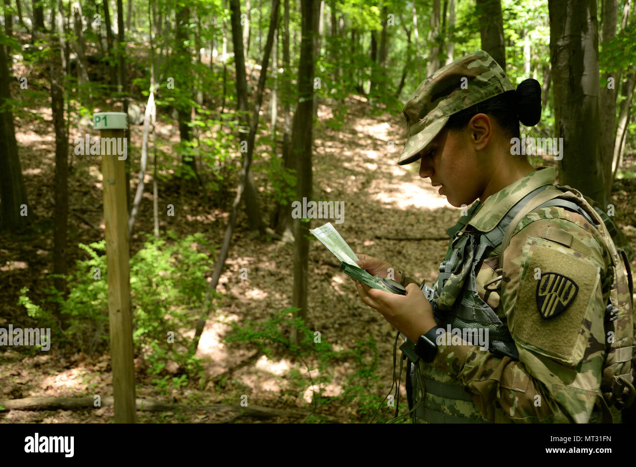 N.Y. Army National Guard Soldier, Spc. Irianis Cruz-Torres, assigned to the 27th Finance Company, finds the direction of her first marker during a Land ...