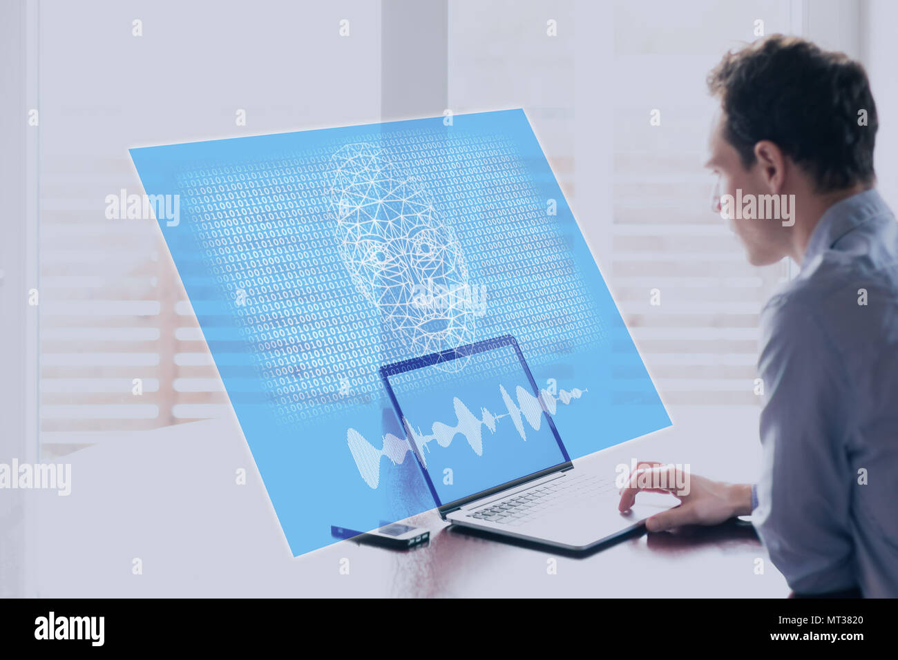 Artificial Intelligence concept with holographic robot face speaking to human on computer screen with binary code, machine learning and AI risks and t - Stock Image