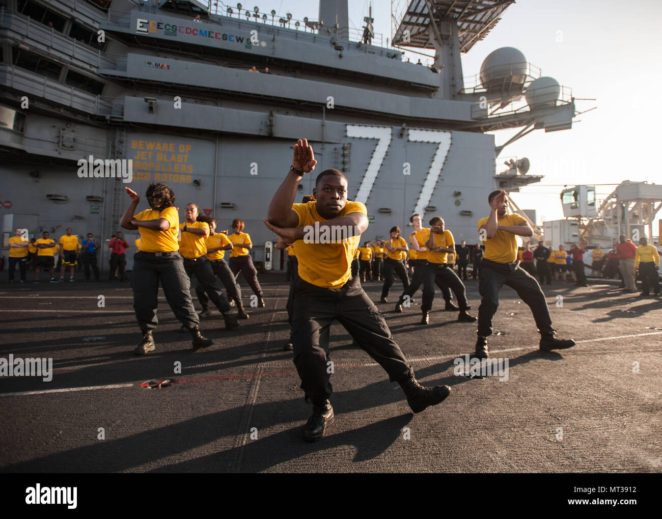 170722-N-ME396-084 MEDITERRANEAN SEA (July 22, 2017) The 77 PSI step team performs before the Suicide Prevention and Awareness Month 5K run aboard the aircraft carrier USS George H.W. Bush (CVN 77). The ship and its carrier strike group are conducting naval operations in the U.S. 6th Fleet area of operations in support of U.S. national security interests in Europe and Africa. (U.S. Navy photo by Mass Communication Specialist 3rd Class Tristan B. Lotz/Released) - Stock Image