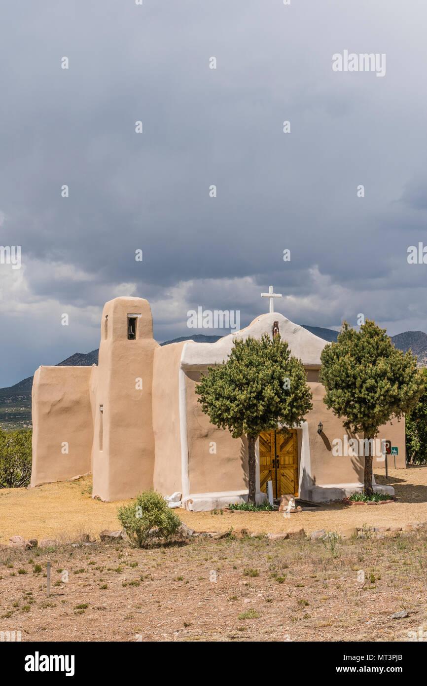 San Francisco de Asis Catholic Church in Golden, New Mexico. It was established in 1839. The church celebrates Fiesta de San Francisco de Assis. - Stock Image