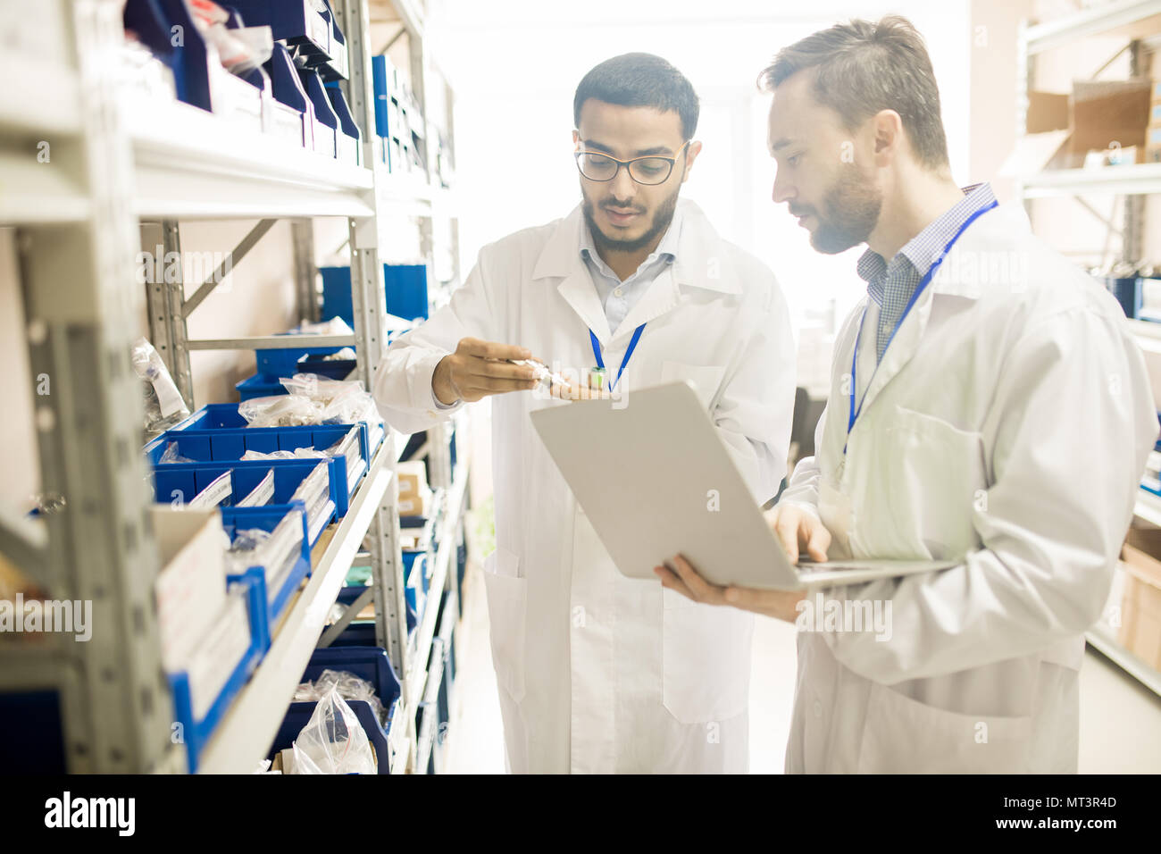 Qualified technicians analyzing measuring devices - Stock Image