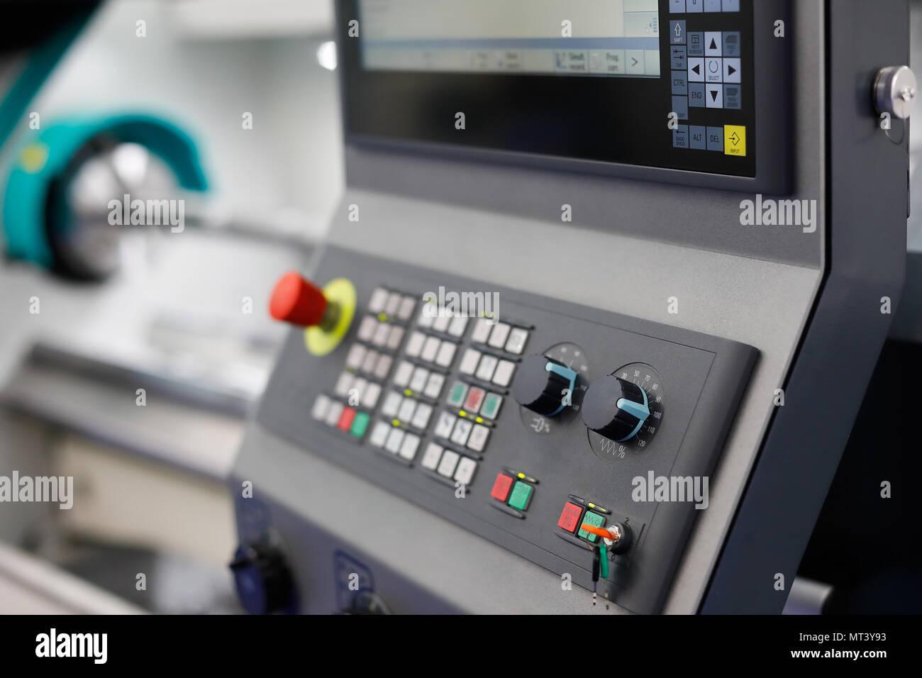 Control panel of the CNC lathe machine. Selective focus. - Stock Image