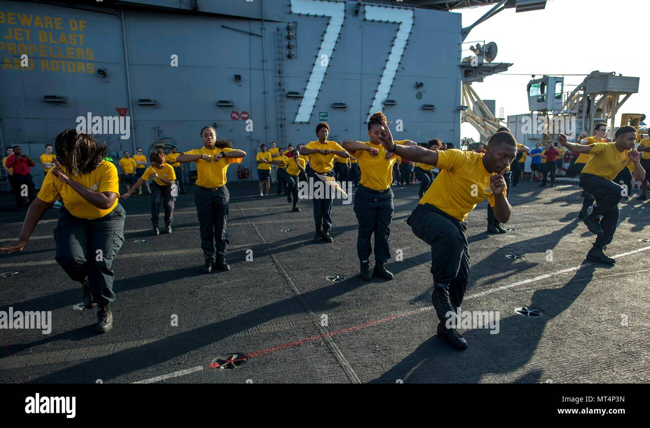 170722-N-NG136-005 MEDITERRANEAN SEA (July 22, 2017) The 77 PSI step team performs before the Suicide Prevention and Awareness Month 5K run aboard the aircraft carrier USS George H.W. Bush (CVN 77). The ship and its carrier strike group are conducting naval operations in the U.S. 6th Fleet area of operations in support of U.S. national security interests in Europe and Africa.  (U.S. Navy photo by Mass Communication Specialist Seaman Zachary Wickline/Released) - Stock Image