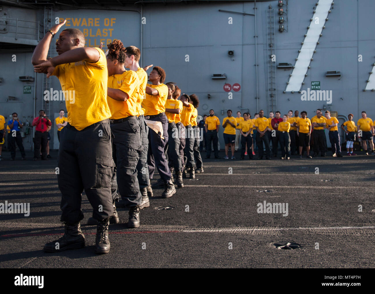 170722-N-ME396-137 MEDITERRANEAN SEA (July 22, 2017) The 77 PSI step team performs before the Suicide Prevention and Awareness Month 5K run aboard the aircraft carrier USS George H.W. Bush (CVN 77). The ship and its carrier strike group are conducting naval operations in the U.S. 6th Fleet area of operations in support of U.S. national security interests in Europe and Africa. (U.S. Navy photo by Mass Communication Specialist 3rd Class Tristan B. Lotz/Released) - Stock Image