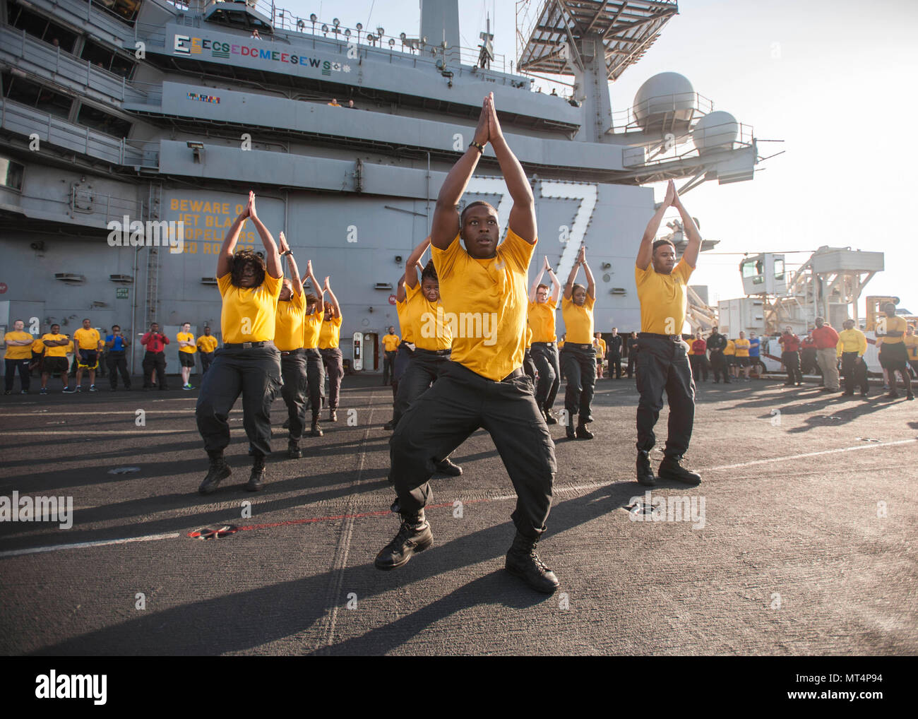170722-N-ME396-068 MEDITERRANEAN SEA (July 22, 2017) The 77 PSI step team performs before the Suicide Prevention and Awareness Month 5K run aboard the aircraft carrier USS George H.W. Bush (CVN 77). The ship and its carrier strike group are conducting naval operations in the U.S. 6th Fleet area of operations in support of U.S. national security interests in Europe and Africa. (U.S. Navy photo by Mass Communication Specialist 3rd Class Tristan B. Lotz/Released) - Stock Image