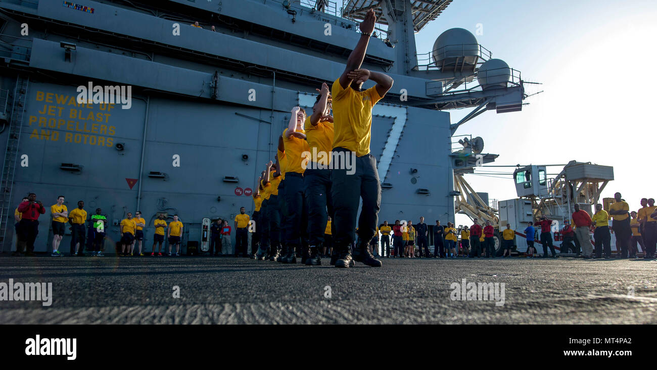 170722-N-NG136-007 MEDITERRANEAN SEA (July 22, 2017) The 77 PSI step team performs before the Suicide Prevention and Awareness Month 5K run aboard the aircraft carrier USS George H.W. Bush (CVN 77). The ship and its carrier strike group are conducting naval operations in the U.S. 6th Fleet area of operations in support of U.S. national security interests in Europe and Africa.  (U.S. Navy photo by Mass Communication Specialist Seaman Zachary Wickline/Released) - Stock Image