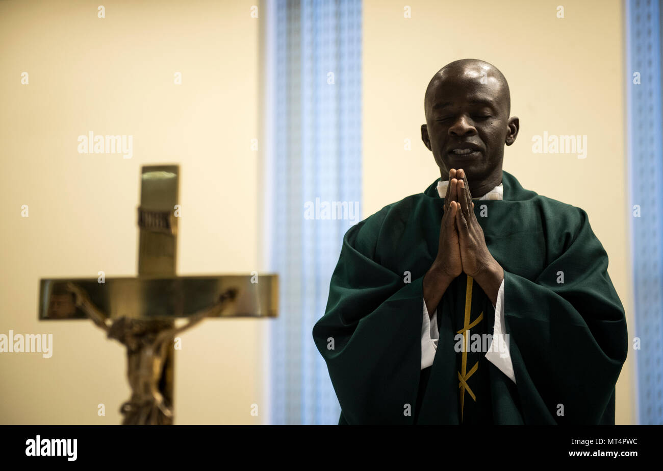 Chaplain (Capt.) John Appiah, 455th Air Expeditionary Wing, leads a prayer during a religious service at Hamid Karzai International Airport, Kabul, Afghanistan, July 23, 2017. Religious support teams from the 455th AEW provide spiritual support in seven locations in Afghanistan. (U.S. Air Force photo by Staff Sgt. Benjamin Gonsier) Stock Photo