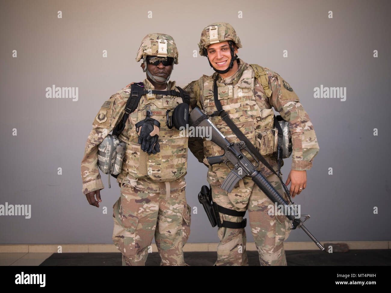 Chaplain (Capt.) John Appiah and Staff Sgt. Christopher Rodriguez, 455th Air Expeditionary Wing, prepare to leave Hamid Karzai International Airport, Kabul, July 23, 2017. Since chaplains are noncombatants, their assistants, though not trained bodyguards, take on the extra responsibility of defending their chaplain if in a hostile situation. (U.S. Air Force photo by Staff Sgt. Benjamin Gonsier) Stock Photo