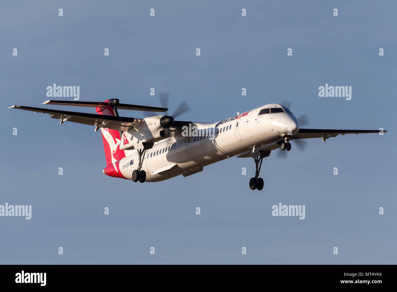 QantasLink De Havilland Canada DHC-8-402Q VH-QOR regional airliner on approach to land at Melbourne International Airport. - Stock Image