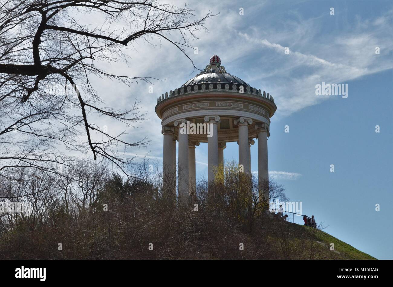 Monopteros in English gardens in Munich in Germany on a good day with blue sky - Stock Image