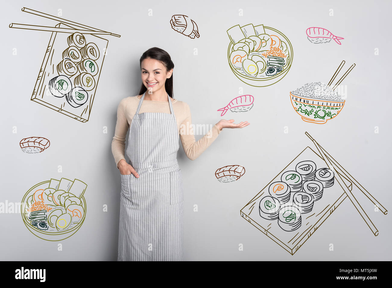 Cheerful waitress smiling and showing Chinese food - Stock Image