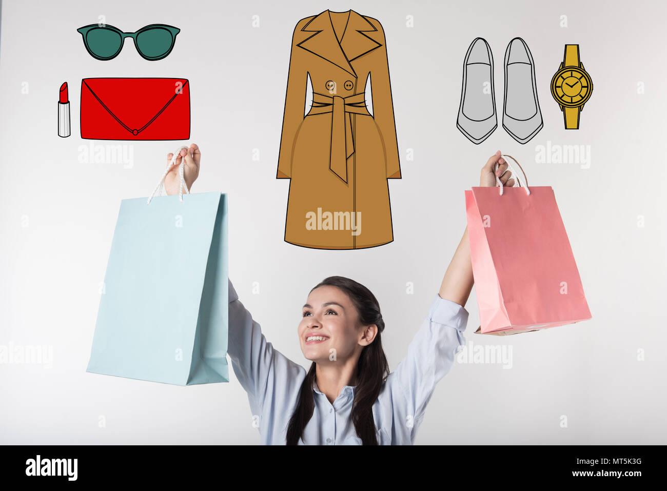 Emotional secretary feeling happy while buying clothes for work - Stock Image