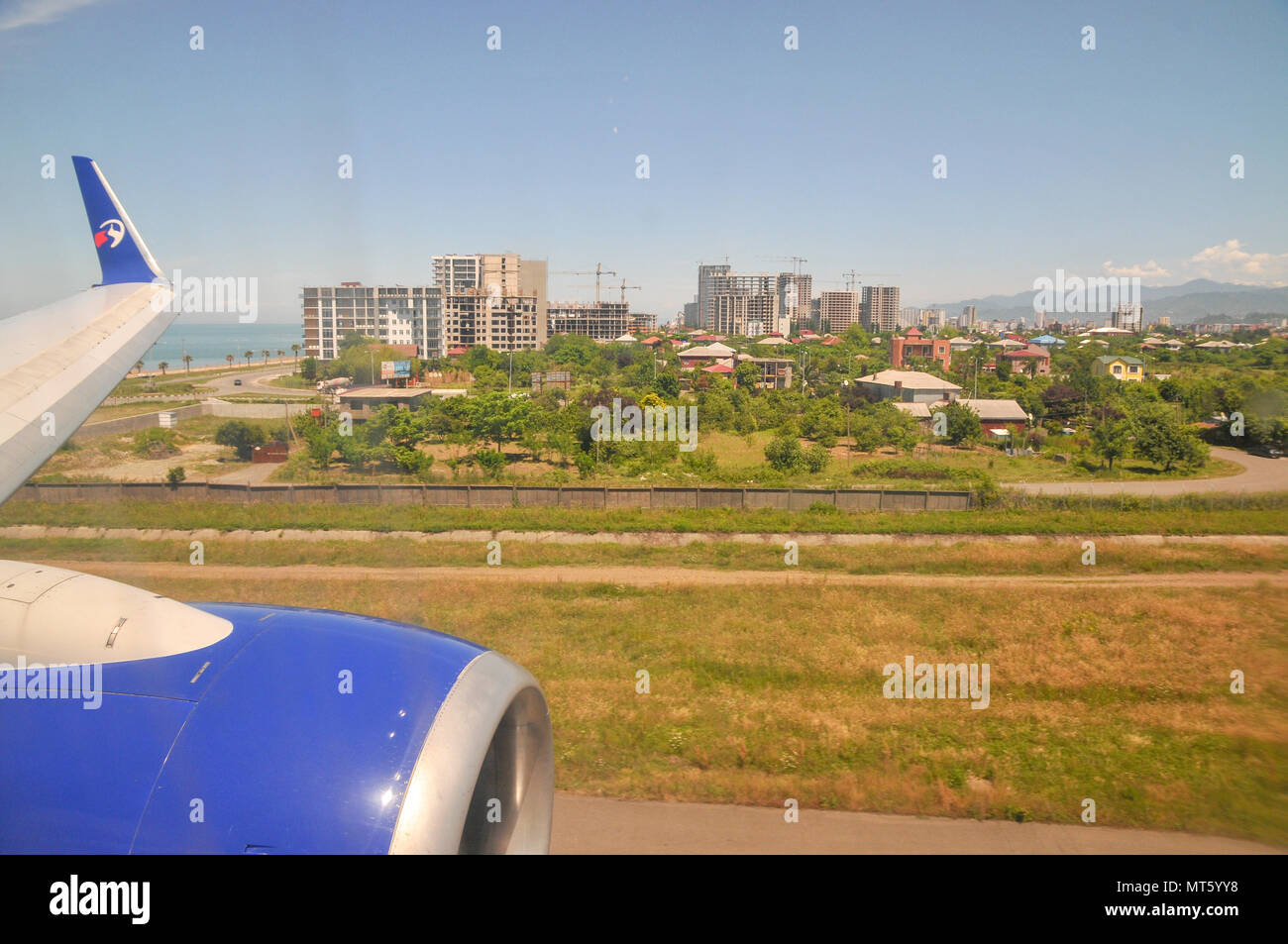 Approaching Batumi, Georgia, as seen from the within the cabin of a Travel Service Airlines (Czech Republic) Boeing 737-800 - Stock Image