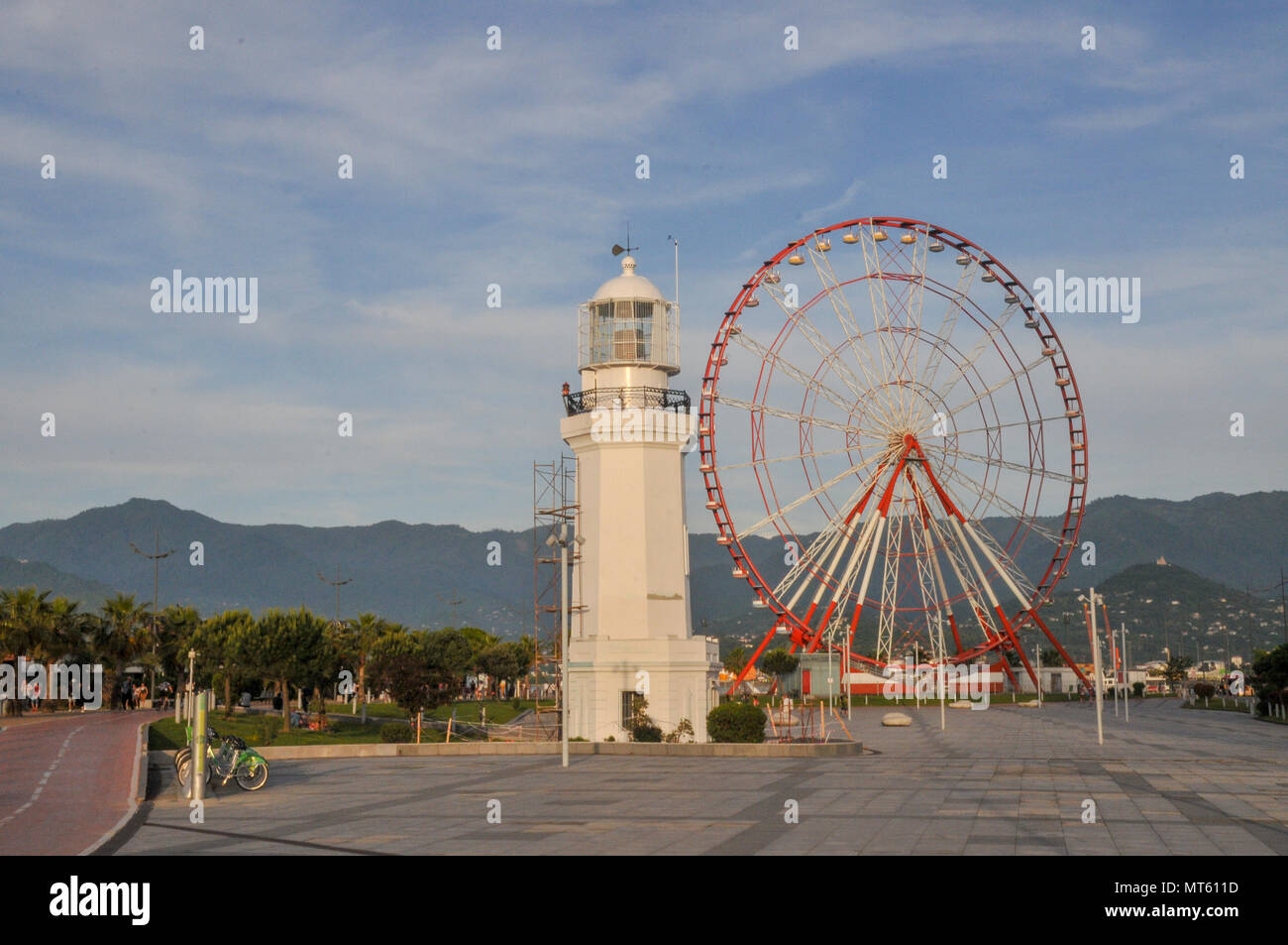Ferris wheel in the Park of Miracles on the embankment. Batumi, Georgia Stock Photo