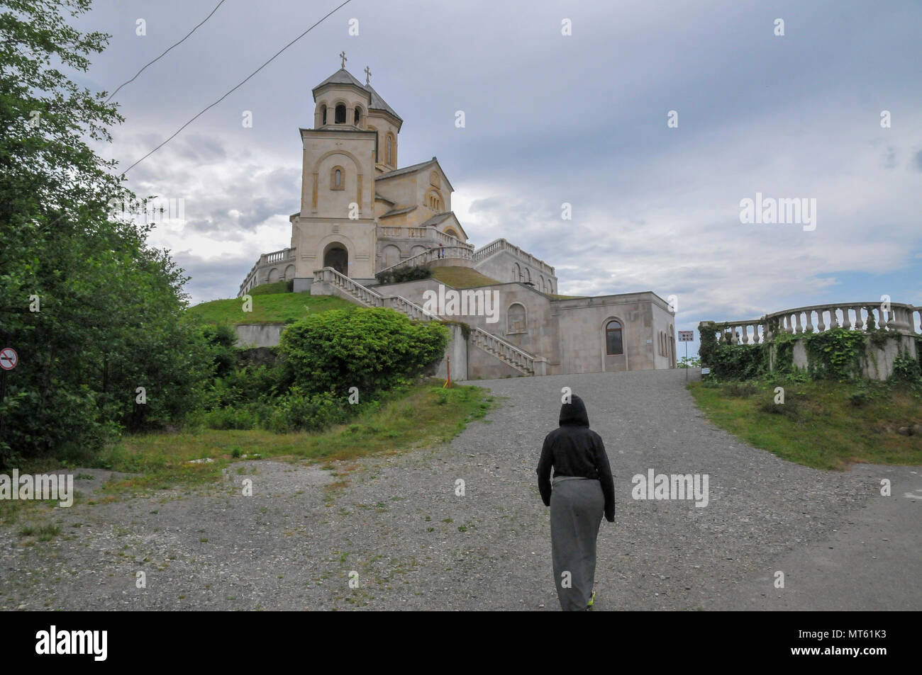 Dress code and restrictions at The Holy Trinity Monastery In Adjara, Georgia overlooking the city of Batumi - Stock Image