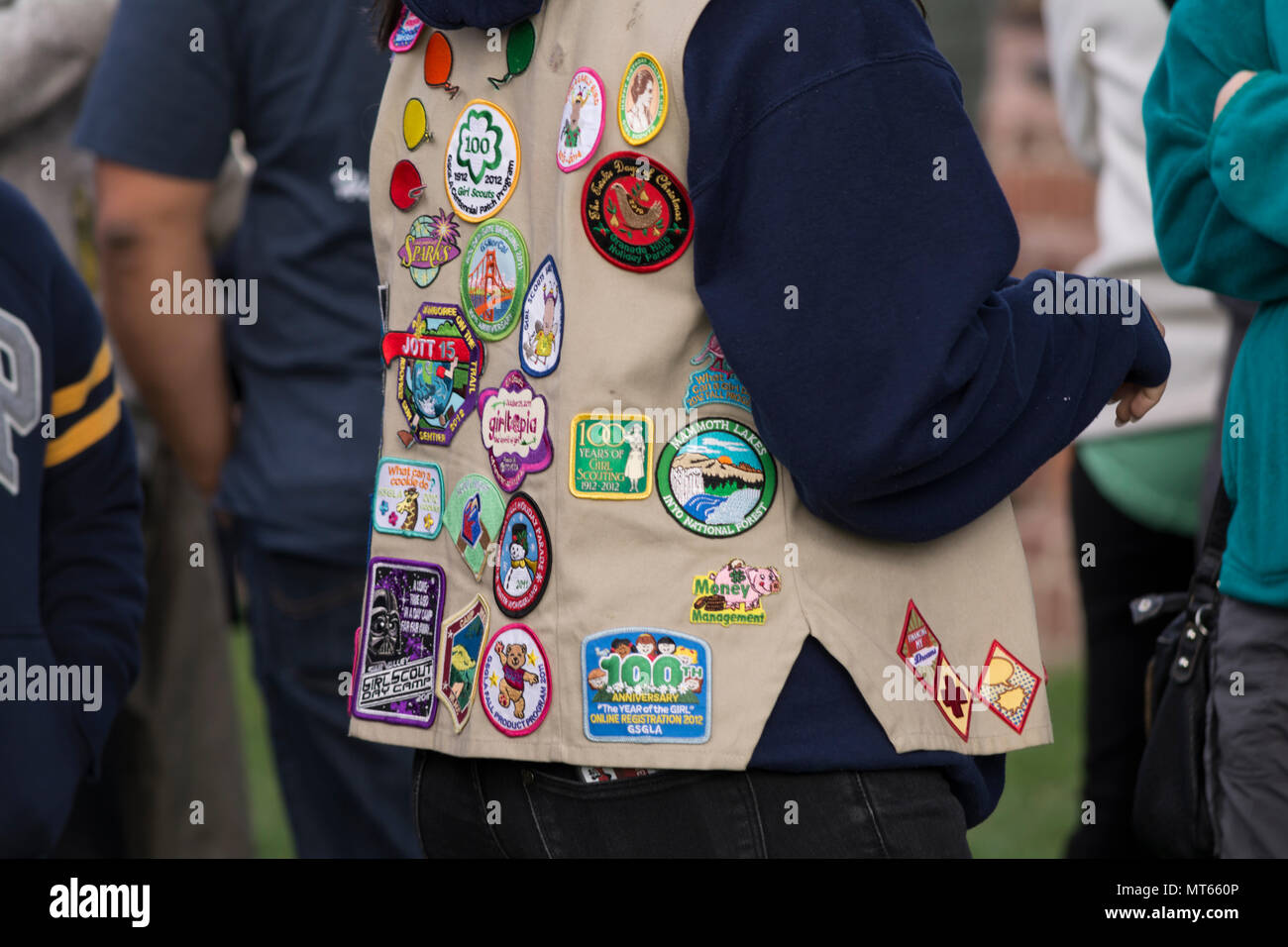 Women wearing a vest with Girl Scouts patches on it Stock