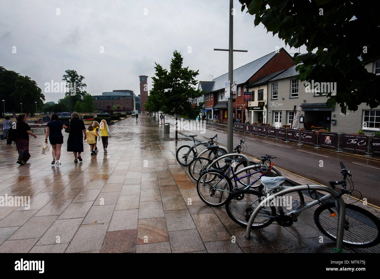Bycicles parked on the raining streets, in Stratford upon Avon, England, UK - Stock Image