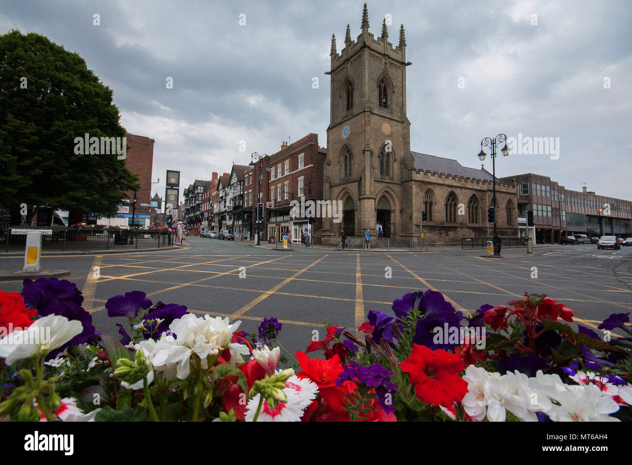 Chester History & Heritage across the street with colorful flower arrangements in the foreground, in Chester, England, UK. - Stock Image