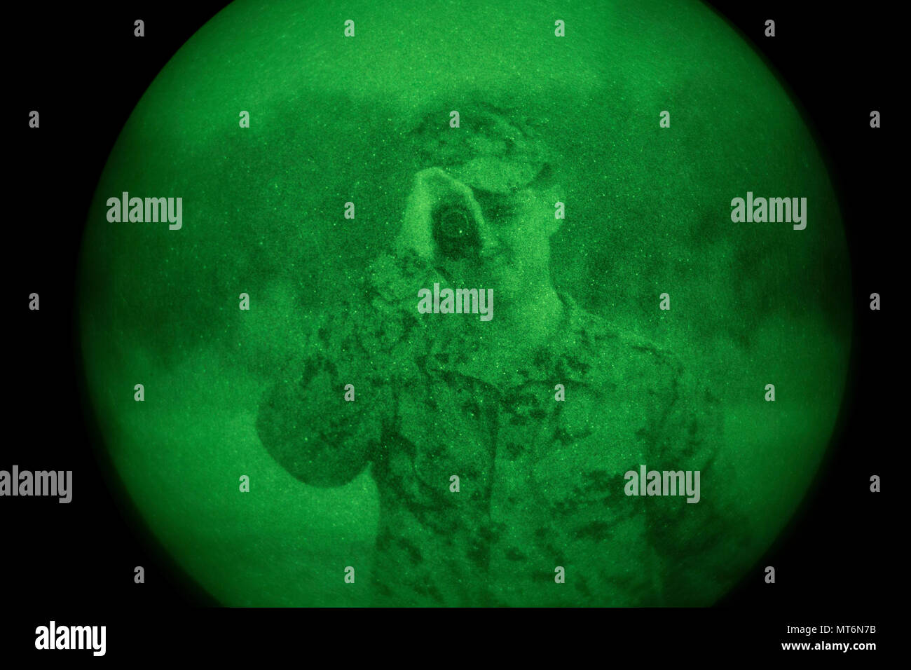 U.S. Marine Corps Cpl. Estuardo Najarro, bust instructor, 2nd Marine Division, looks through a PVS-14 night vision device during Career Orientated Training for Midshipmen (CORTRAMID) Marine Week, Camp Lejeune, N.C., July 25, 2017. The purpose of CORTRAMID is to expose students to opportunities in the Fleet Marine Forces and generate an interest in a Marine Corps commission. (U.S. Marine Corps photo by Lance Cpl. Ashley D. Gomez) Stock Photo