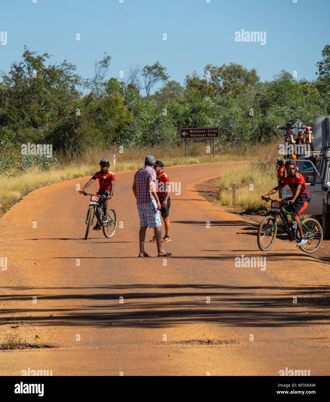 Two indigenous cyclists and their support crew on The Gibb River Road, the Gibb Challenge 2018 Kimberley, WA, Australia. - Stock Image