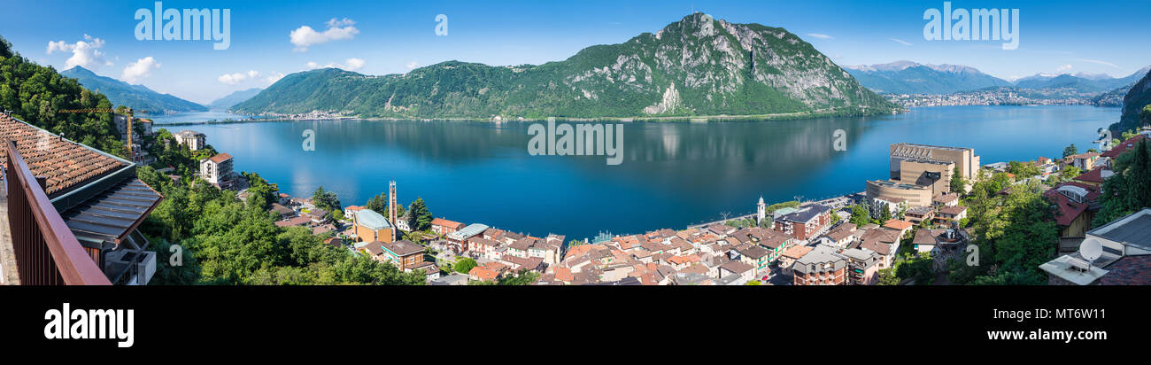 Lake Lugano. Panoramic view of Campione d'Italia, famous for its casino. In the background on the right the city of Lugano Stock Photo