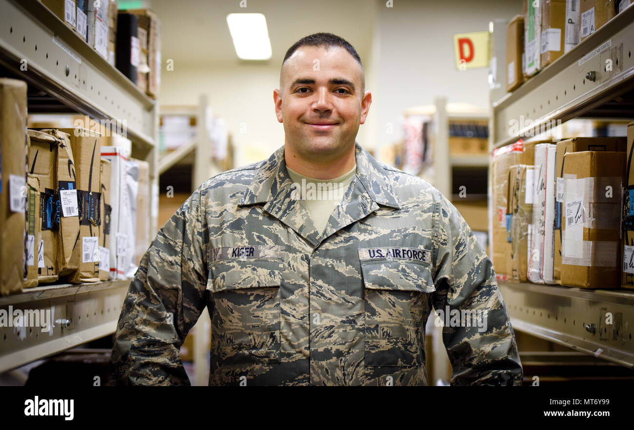 Staff Sgt. Justin Kiser, 374th Communication Squadron custodian of postal effects, poses for a photo, July 5, 2017, at Yokota Air Base, Japan. Kiser was selected as Airlifter of the Week for his dedication to leading postal finance section team and providing postal service to 11,500 customers. (U.S. Air Force Photo by Machiko Arita) - Stock Image