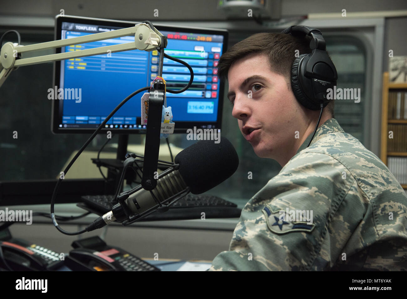 Airman Samuel Burns, AFN Tokyo broadcast producer, speaks over a microphone during his radio show, May 1, 2017, at Yokota Air Base, Japan. Burns was selected as  Airlifter of the Week for his dedication to hosting radio show for largest AFN station in the pacific. (U.S. Air Force Photo by Machiko Arita) - Stock Image