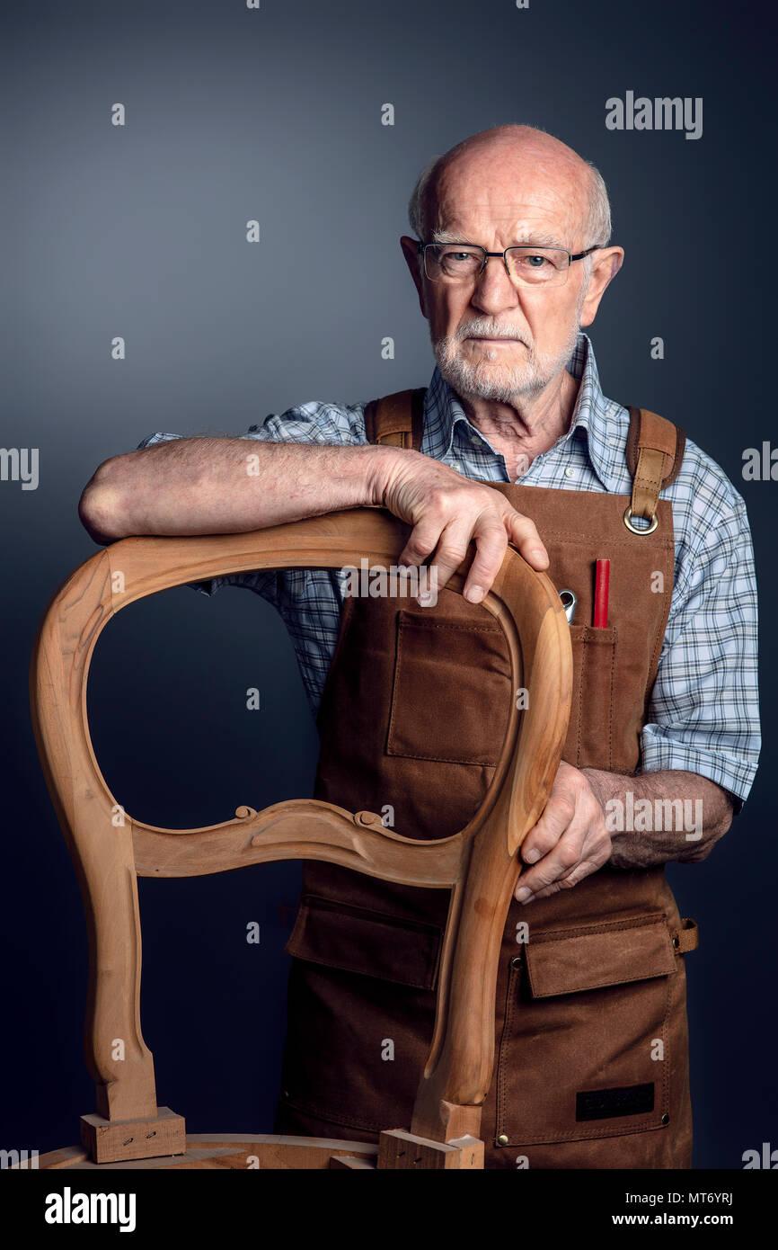 studio portrait of senior craftsman - Stock Image