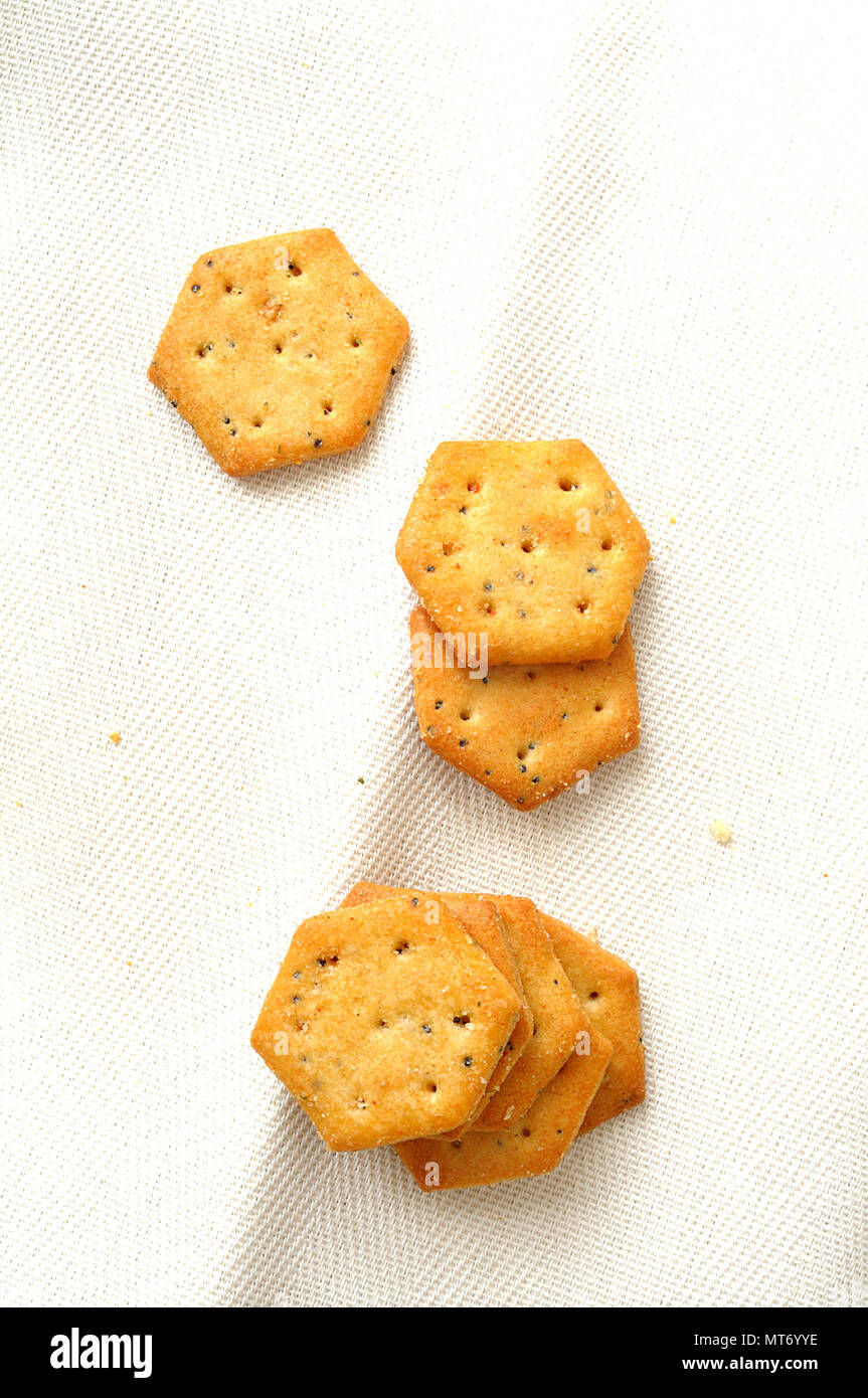 vertical background of savory snack on white cloth, top view - Stock Image