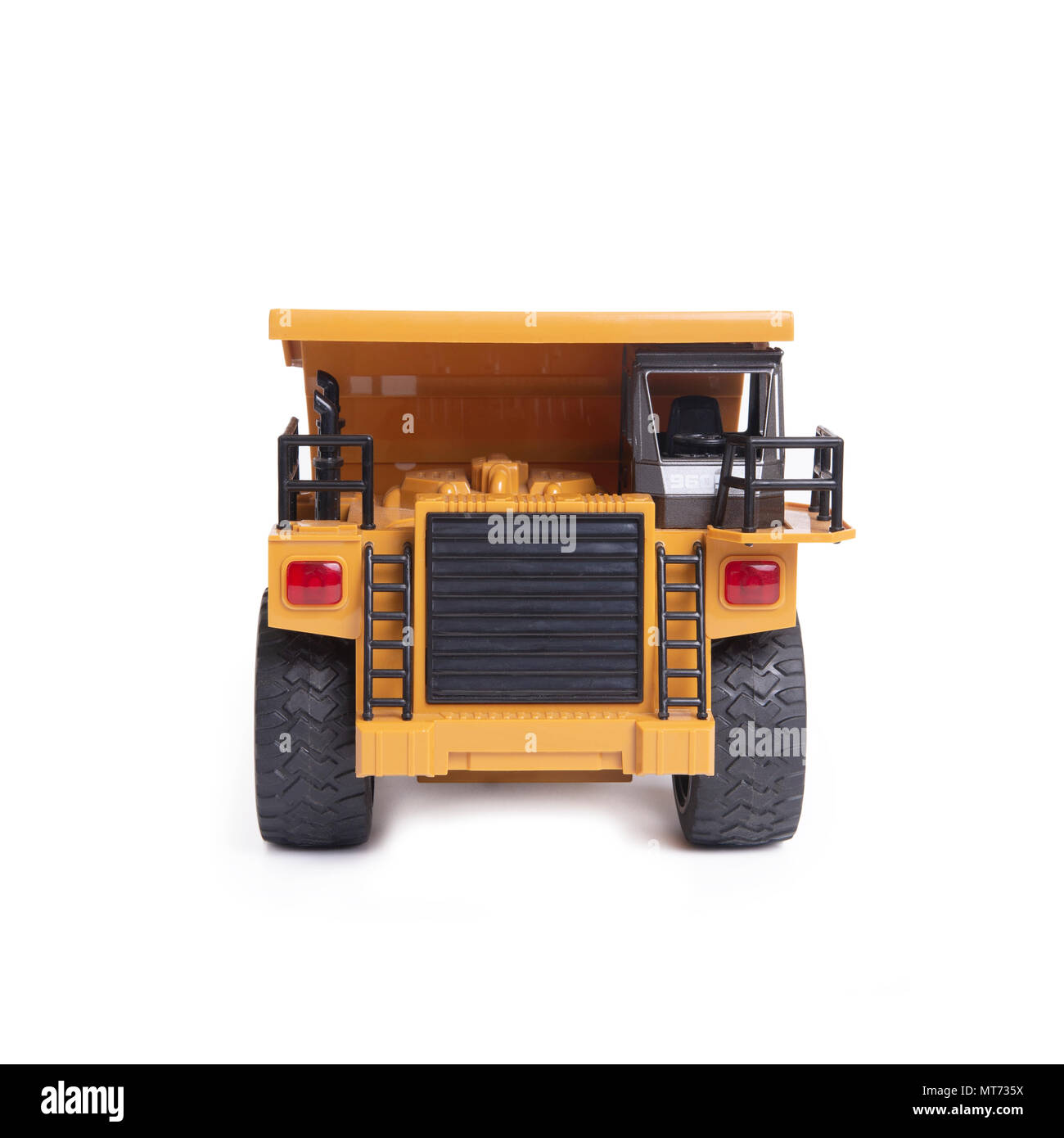 Front view of yellow truck toy model on white background. - Stock Image