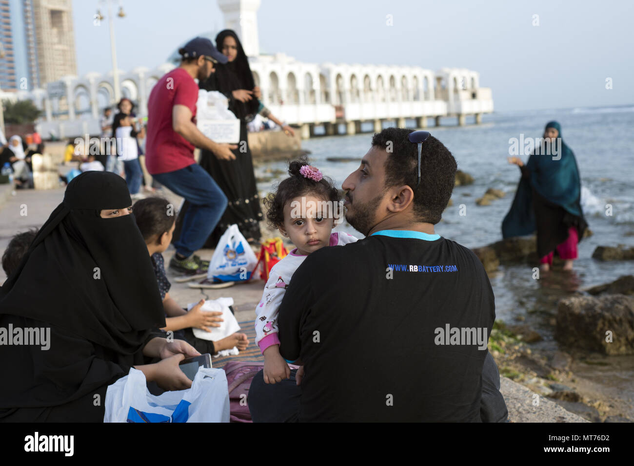 Muslims gathered by floating mosque in Jeddah, Saudi Arabia in preparation of breaking the fast during Ramada - Stock Image