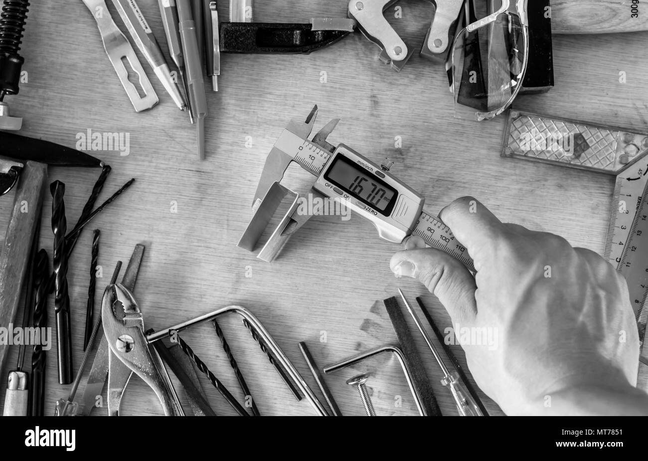 black and white many different tools in mess - Stock Image